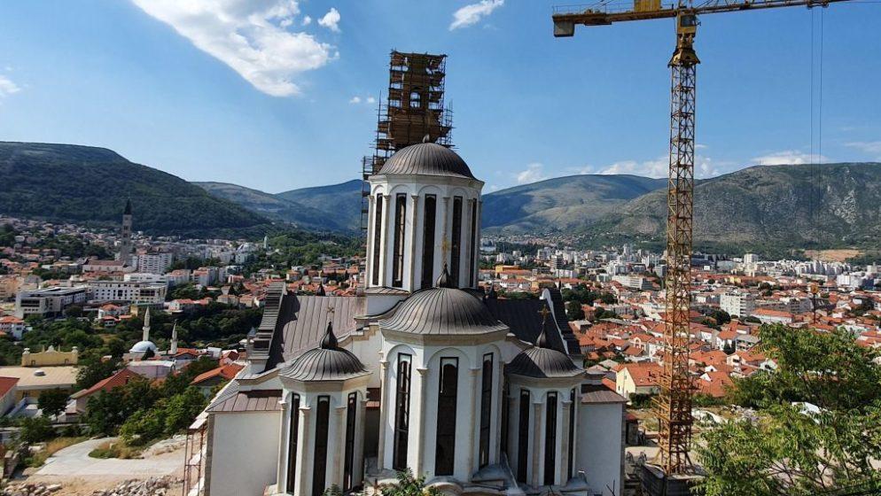 CRKVA U MOSTARU SIMBOL POMIRENJA Tri sata na zvoniku donirali pravoslavac, katolik i musliman